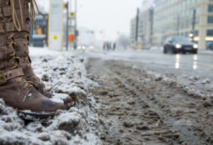 snowy boots 300x205 - Getting Wintertime Matting Right – By the Experts in Clean Floors