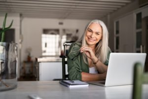 woman smiling 300x200 - Tips for Preparing Staff to Work Remotely