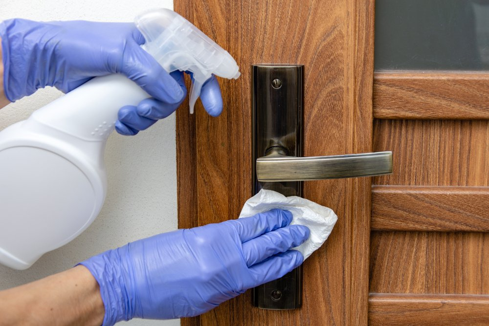 disinfecting a door handle